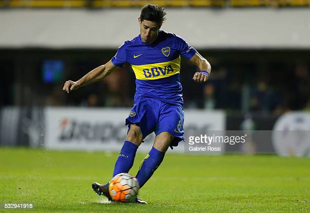 Pablo Perez of Boca Juniors kicks from the penalty spot during a second leg match between Boca Juniors and Nacional as part of quarter finals of Copa...