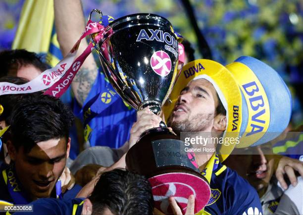 Pablo Perez of Boca Juniors lifts the champions trophy to celebrate after a match between Boca Juniors and Union as part of Torneo Primera Division...