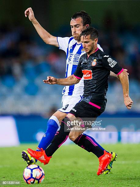 Pablo Piatti of RCD Espanyol duels for the ball with Mikel Gonzalez of Real Sociedad during the La Liga match between Real Sociedad de Futbol and RCD...