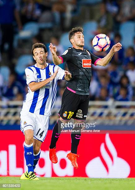 Pablo Piatti of RCD Espanyol duels for the ball with Ruben Pardo of Real Sociedad during the La Liga match between Real Sociedad de Futbol and RCD...