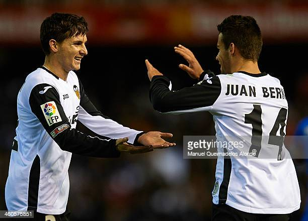 Pablo Piatti of Valencia celebrate after scoring with his teammate Juan Bernat during the La Liga match between Valencia CF and Levante UD at Estadio...