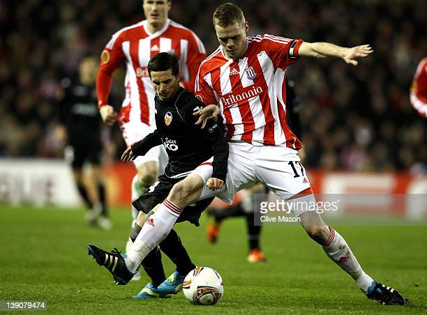 Pablo Piatti of Valencia CF competes with Ryan Shawcross of Stoke City during the UEFA Europa League Round of 32 First leg match between Stoke City...