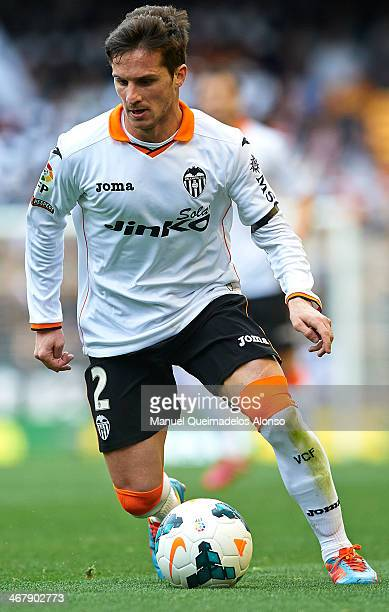 Pablo Piatti of Valencia CF runs with the ball during the La Liga match between Valencia CF and Real Betis Balompie at Estadio Mestalla on February...