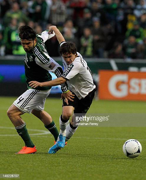 Pablo Piatti of Valencia is tripped up by Mike Chabala of the Portland Timbers at JeldWen Field on May 23 2012 in Portland Oregon