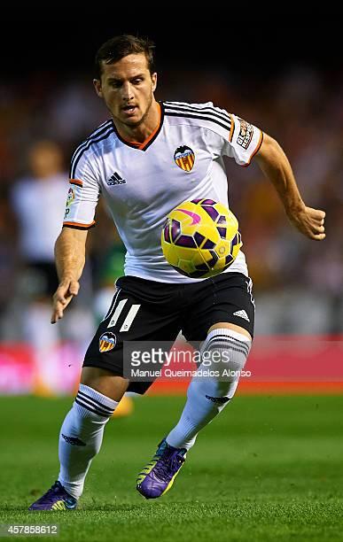 Pablo Piatti of Valencia runs with the ball during the La Liga match between Valencia CF and Elche CF at Estadio Mestalla on October 25 2014 in...