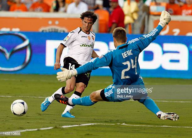 Pablo Piatti of Valencia shoots wide past goalkeeper Tyler Deric of the Houston Dynamo at BBVA Compass Stadium on May 31 2012 in Houston Texas...