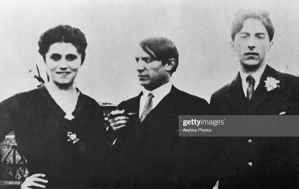 Pablo Picasso, centre, with his first wife Olga Khokhlova and French artist Jean Cocteau, 1917.