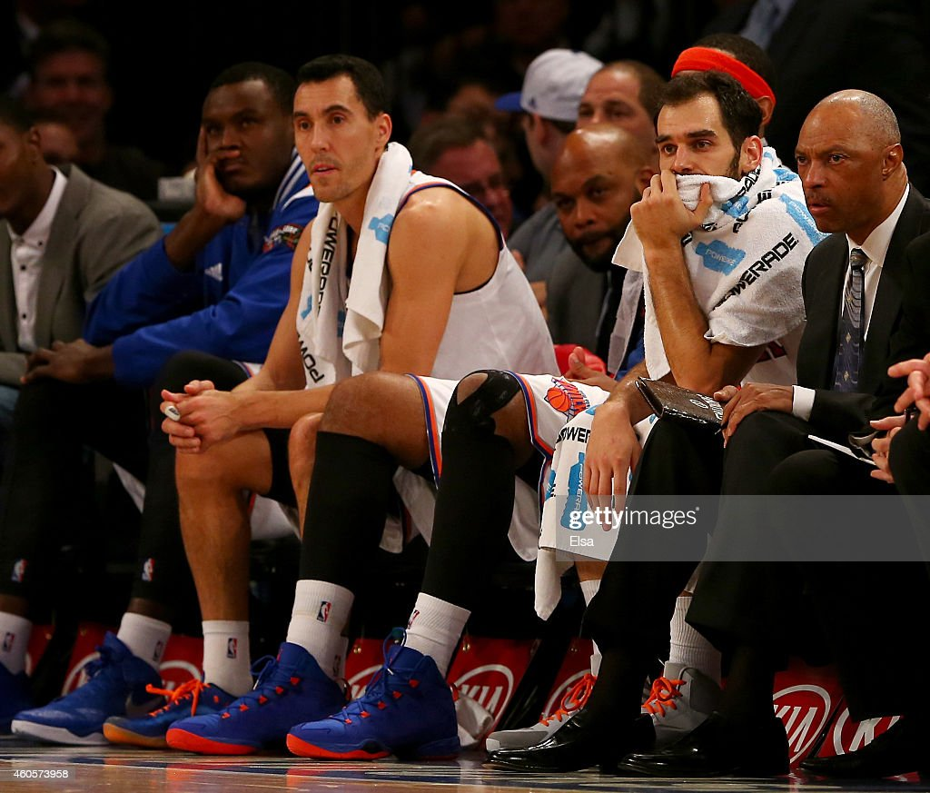 Pablo Prigioni #9 and Jose Calderon #3 of the New York Knicks react late in the fourth quarter against the Dallas Mavericks at Madison Square Garden on December 16, 2014 in New York City.The Dallas Mavericks defeated the New York Knicks 107-87.