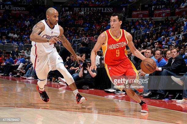 Pablo Prigioni of the Houston Rockets drives against Dahntay Jones of the Los Angeles Clippers in Game Four of the Western Conference Semifinals...