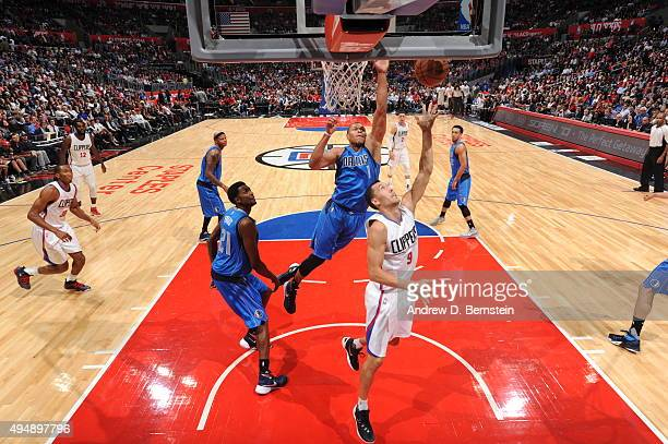 Pablo Prigioni of the Los Angeles Clippers hooks the shot against Justin Anderson of the Dallas Mavericks during the game on October 29 2015 at...