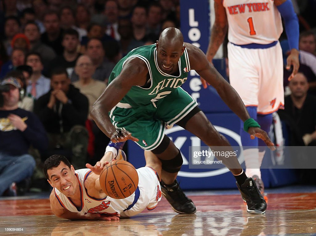 Pablo Prigioni #9 of the New York Knicks and Kevin Garnett #5 of the Boston Celtics struggle for a loose ball at Madison Square Garden on January 7, 2013 in New York City.