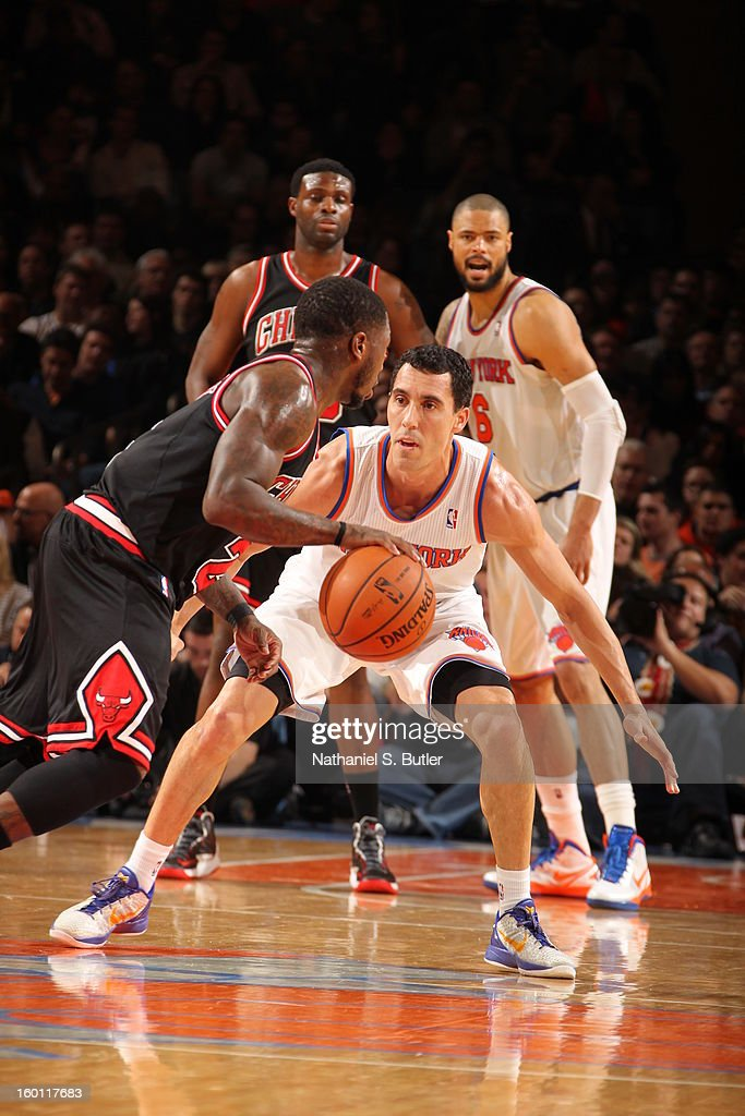 <a gi-track='captionPersonalityLinkClicked' href=/galleries/search?phrase=Pablo+Prigioni&family=editorial&specificpeople=664673 ng-click='$event.stopPropagation()'>Pablo Prigioni</a> #9 of the New York Knicks defends <a gi-track='captionPersonalityLinkClicked' href=/galleries/search?phrase=Nate+Robinson&family=editorial&specificpeople=208906 ng-click='$event.stopPropagation()'>Nate Robinson</a> #2 of the Chicago Bulls on January 11, 2013 at Madison Square Garden in New York City.