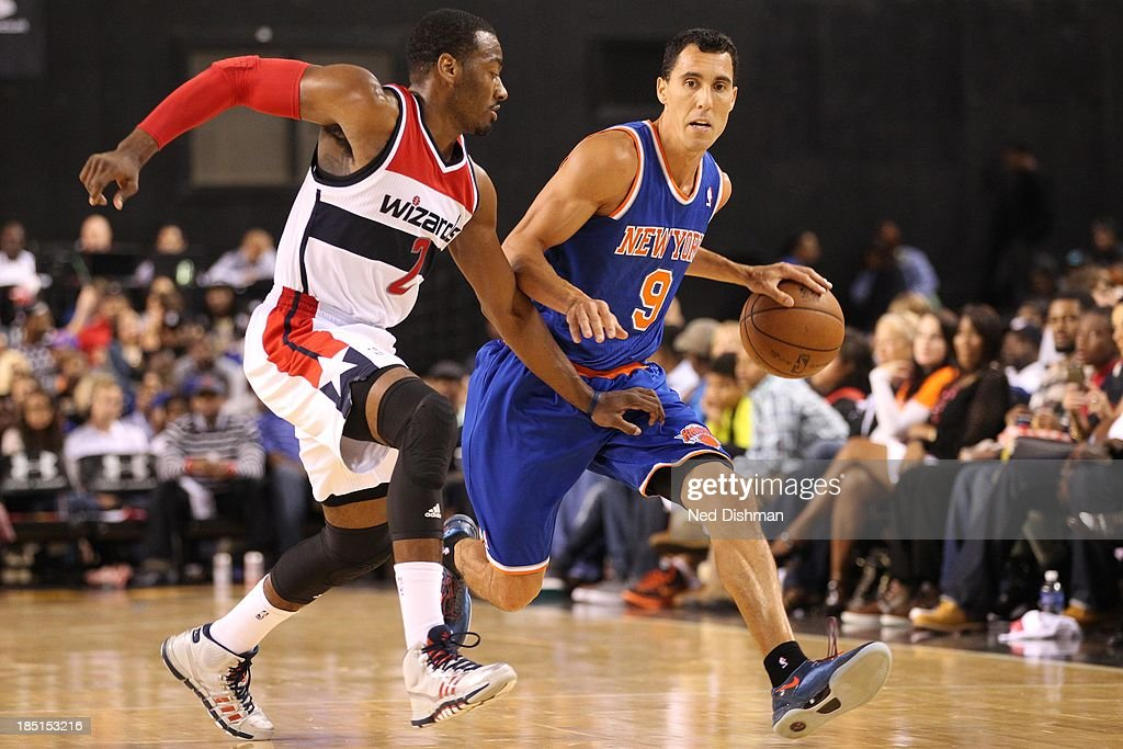 <a gi-track='captionPersonalityLinkClicked' href=/galleries/search?phrase=Pablo+Prigioni&family=editorial&specificpeople=664673 ng-click='$event.stopPropagation()'>Pablo Prigioni</a> #9 of the New York Knicks drives against <a gi-track='captionPersonalityLinkClicked' href=/galleries/search?phrase=John+Wall&family=editorial&specificpeople=2265812 ng-click='$event.stopPropagation()'>John Wall</a> #2 of the Washington Wizards during the pre-season game at the Baltimore Arena on October 17, 2013 in Baltimore, MD.