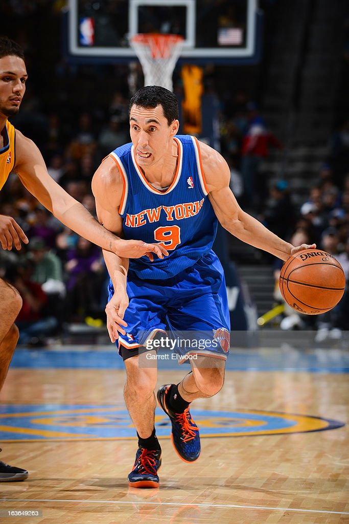<a gi-track='captionPersonalityLinkClicked' href=/galleries/search?phrase=Pablo+Prigioni&family=editorial&specificpeople=664673 ng-click='$event.stopPropagation()'>Pablo Prigioni</a> #9 of the New York Knicks drives against the Denver Nuggets on March 13, 2013 at the Pepsi Center in Denver, Colorado.