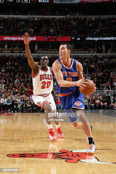 Pablo Prigioni of the New York Knicks drives against Tony Snell of the Chicago Bulls at the United Center on December 18 2014 in Chicago Illinois...