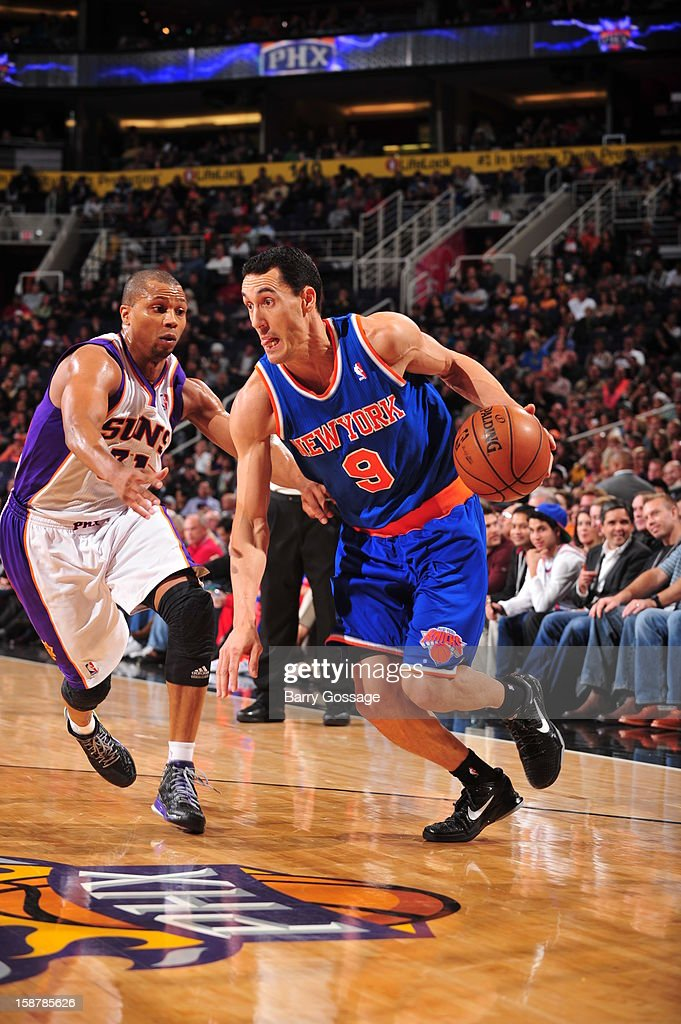 <a gi-track='captionPersonalityLinkClicked' href=/galleries/search?phrase=Pablo+Prigioni&family=editorial&specificpeople=664673 ng-click='$event.stopPropagation()'>Pablo Prigioni</a> #9 of the New York Knicks drives to the basket against the Phoenix Suns on December 26, 2012 at U.S. Airways Center in Phoenix, Arizona.