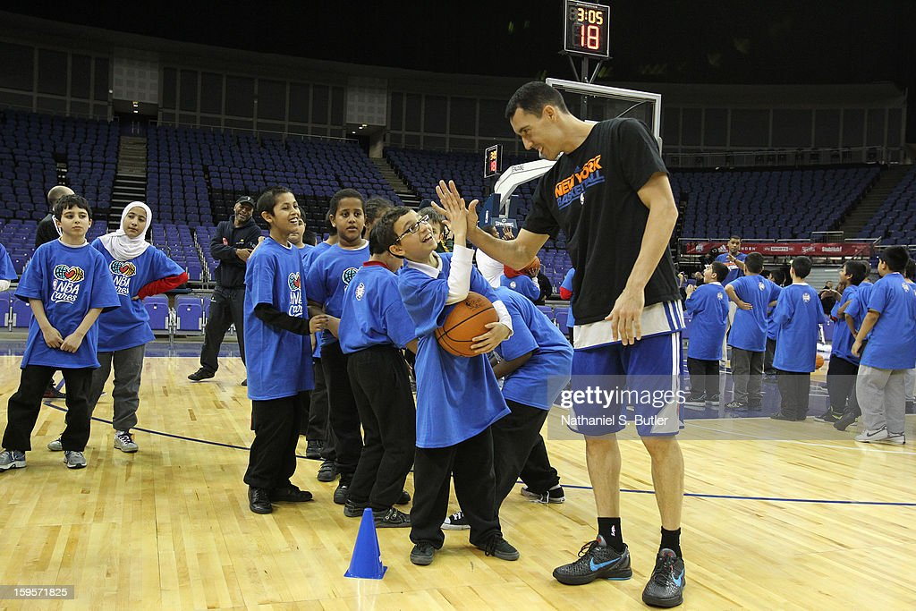Pablo Prigioni #9 of the New York Knicks high fives a kid during the NBA Cares Clinic at the O2 Arena as part of the NBA London Live 2013 on January 16, 2013 in London, England.