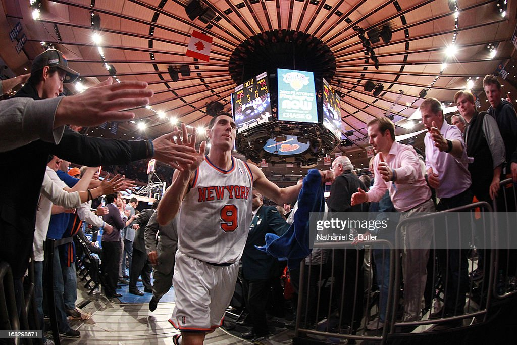 Pablo Prigioni #9 of the New York Knicks high fives fans as the New York Knicks defeat the Indiana Pacers in Game Two of the Eastern Conference Semifinals during the 2013 NBA Playoffs on May 7, 2013 at Madison Square Garden in New York City.