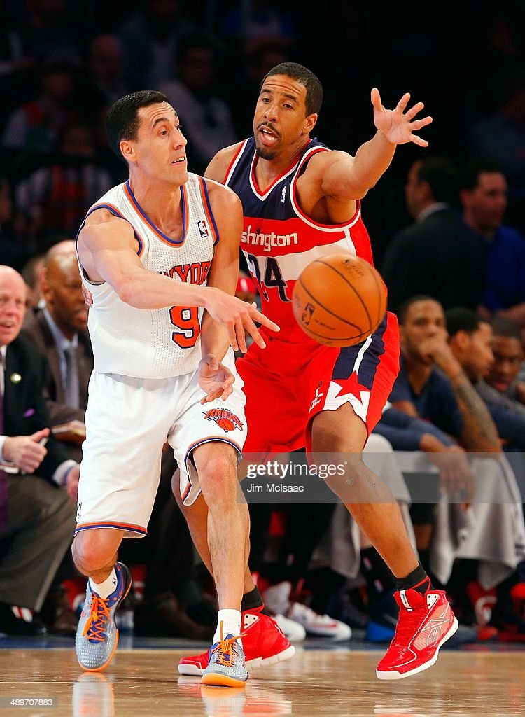 Pablo Prigioni #9 of the New York Knicks in action against Andre Miller #24 of the Washington Wizards at Madison Square Garden on April 4, 2014 in New York City. The Wizards defeated the Knicks 90-89.