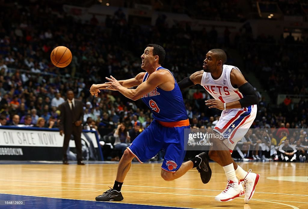 Pablo Prigioni #9 of the New York Knicks in action against C.J. Watson #1 of the Brooklyn Nets during a preseason game at Nassau Coliseum on October 24 2012 in Uniondale, New York The Knicks defeated the Nets 97-95.