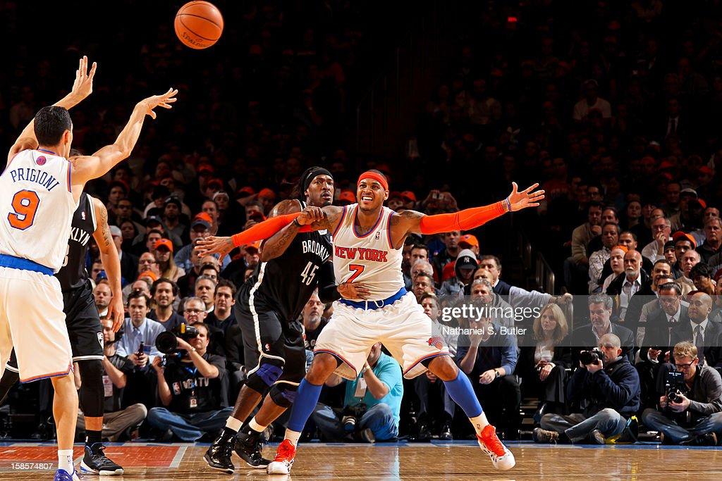 Pablo Prigioni #9 of the New York Knicks passes the ball to teammate Carmelo Anthony #7 against Gerald Wallace #45 of the Brooklyn Nets on December 19, 2012 at Madison Square Garden in New York City.