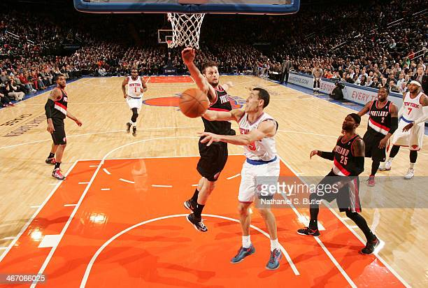 Pablo Prigioni of the New York Knicks shoots against Joel Freeland of the Portland Trail Blazers during a game at Madison Square Garden in New York...