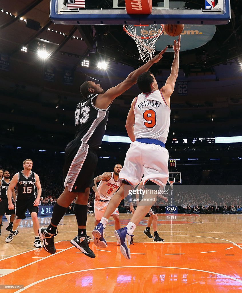 Pablo Prigioni #9 of the New York Knicks takes the shot against the San Antonio Spurs at Madison Square Garden on January 3, 2013 in New York City.