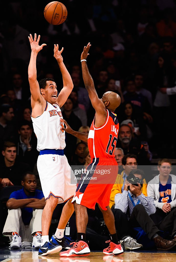 <a gi-track='captionPersonalityLinkClicked' href=/galleries/search?phrase=Pablo+Prigioni&family=editorial&specificpeople=664673 ng-click='$event.stopPropagation()'>Pablo Prigioni</a> #9 of the New York Knicks throws up the ball in front of <a gi-track='captionPersonalityLinkClicked' href=/galleries/search?phrase=John+Lucas+III&family=editorial&specificpeople=784337 ng-click='$event.stopPropagation()'>John Lucas III</a> #15 of the Washington Wizards in a preseason game at Madison Square Garden on October 22, 2014 in New York City.