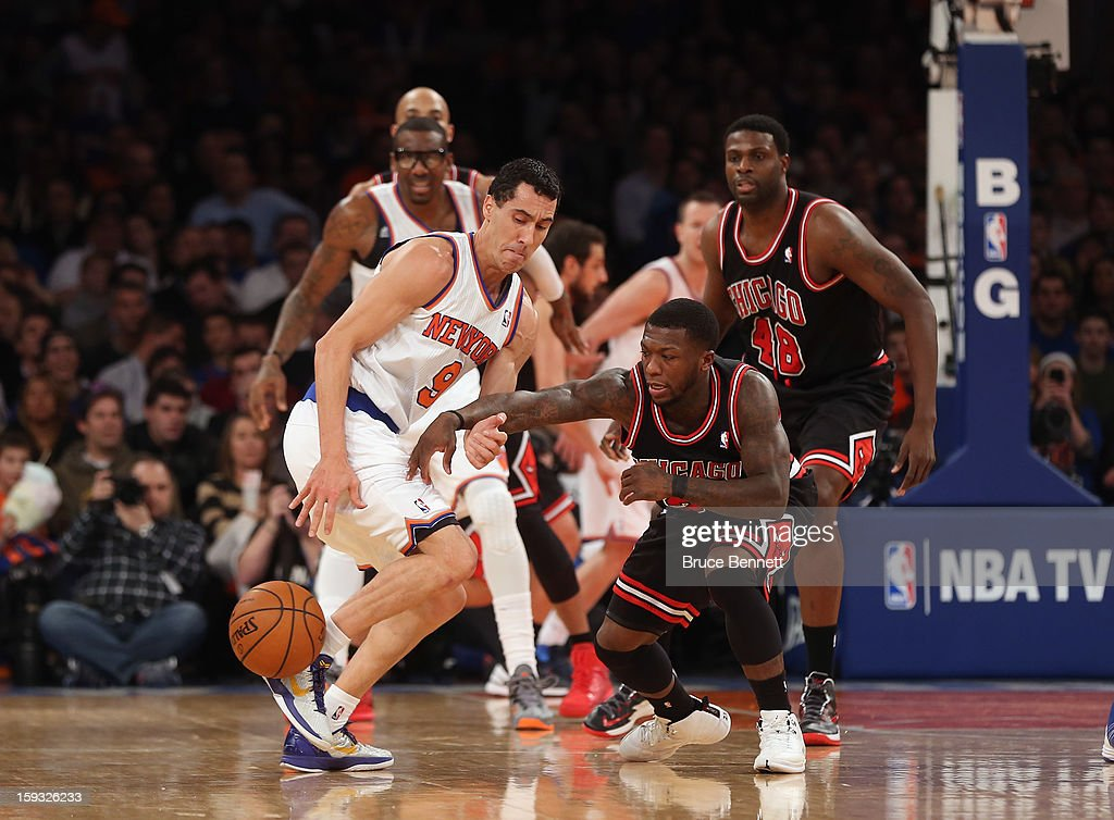 Pablo Prigioni #9 of the New York Knicks tries to move the ball past Nate Robinson #2 of the Chicago Bulls at Madison Square Garden on January 11, 2013 in New York City.