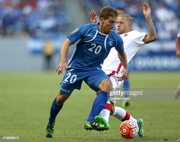 Pablo Punyed of El Salvador plays the ball in front of Marcel De Jong of Canada in their CONCACAF Gold Cup Group B match at StubHub Center on July 8...