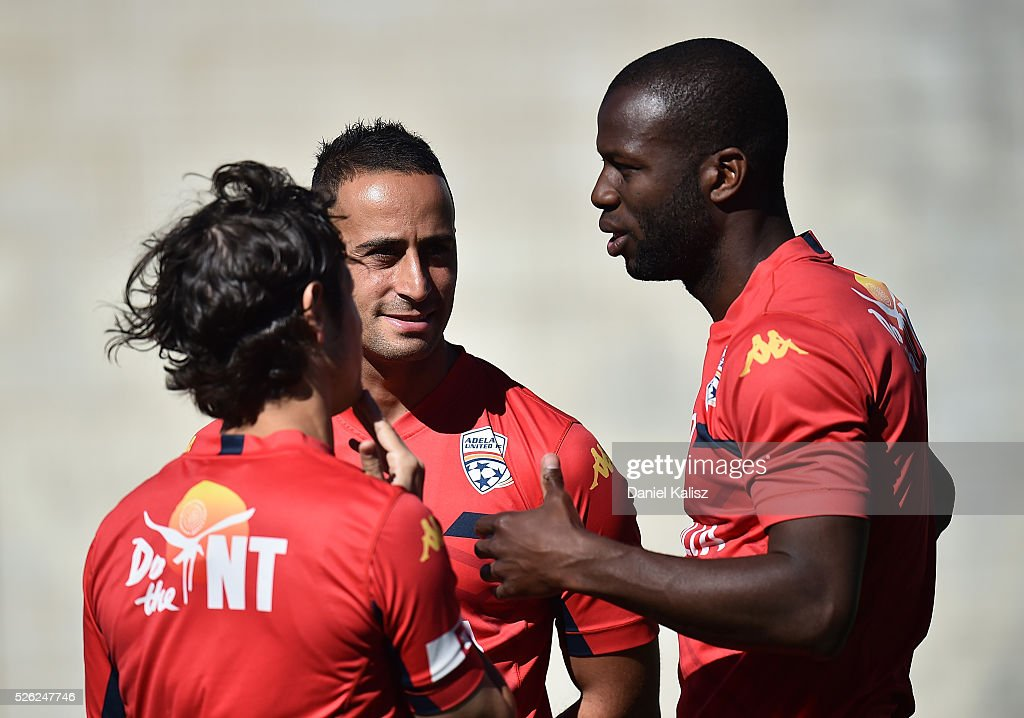 Pablo Sanchez Alberto of United chats with Bruce Djite of United during an Adelaide United A-League training session at Coopers Stadium on April 30, 2016 in Adelaide, Australia.