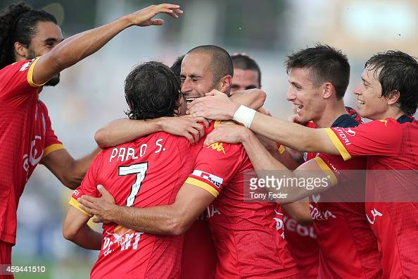 Pablo Sanchez of Adelaide celebrates with team mates after scoring a goal during the round seven ALeague match between the Central Coast Mariners and...