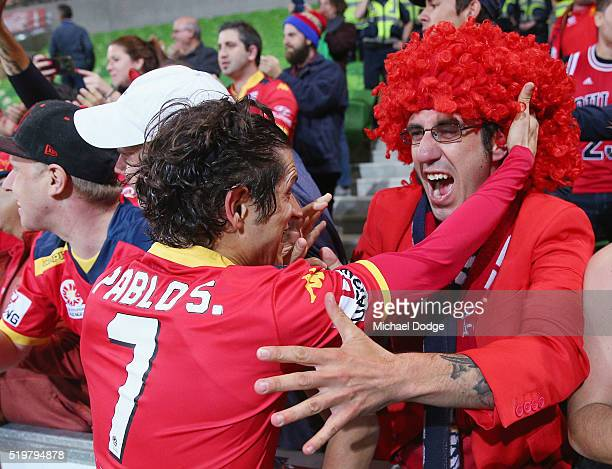 Pablo Sanchez of United celebrates the win with fans during the round 27 ALeague match between the Melbourne City FC and Adelaide United at AAMI Park...