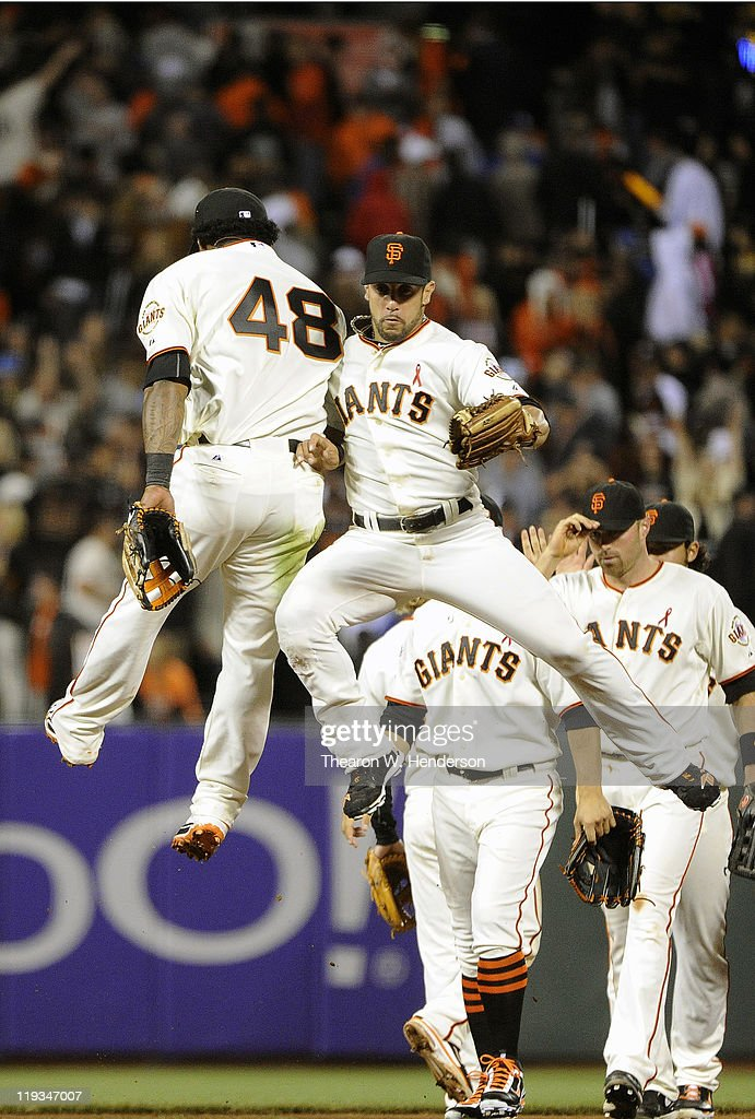 <a gi-track='captionPersonalityLinkClicked' href=/galleries/search?phrase=Pablo+Sandoval&family=editorial&specificpeople=803207 ng-click='$event.stopPropagation()'>Pablo Sandoval</a> #48 and <a gi-track='captionPersonalityLinkClicked' href=/galleries/search?phrase=Andres+Torres&family=editorial&specificpeople=835839 ng-click='$event.stopPropagation()'>Andres Torres</a> #56 of the San Francisco Giants celebrate defeating the Los Angeles Dodgers 5-0 in an MLB baseball game at AT&T Park July 18, 2011 in San Francisco, California.