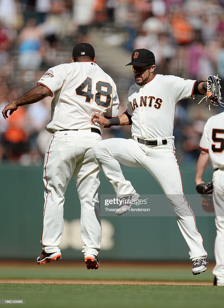 <a gi-track='captionPersonalityLinkClicked' href=/galleries/search?phrase=Pablo+Sandoval&family=editorial&specificpeople=803207 ng-click='$event.stopPropagation()'>Pablo Sandoval</a> #48 and <a gi-track='captionPersonalityLinkClicked' href=/galleries/search?phrase=Andres+Torres&family=editorial&specificpeople=835839 ng-click='$event.stopPropagation()'>Andres Torres</a> #56 of the San Francisco Giants celebrates defeating the Colorado Rockies 10-0 at AT&T Park on April 10, 2013 in San Francisco, California.