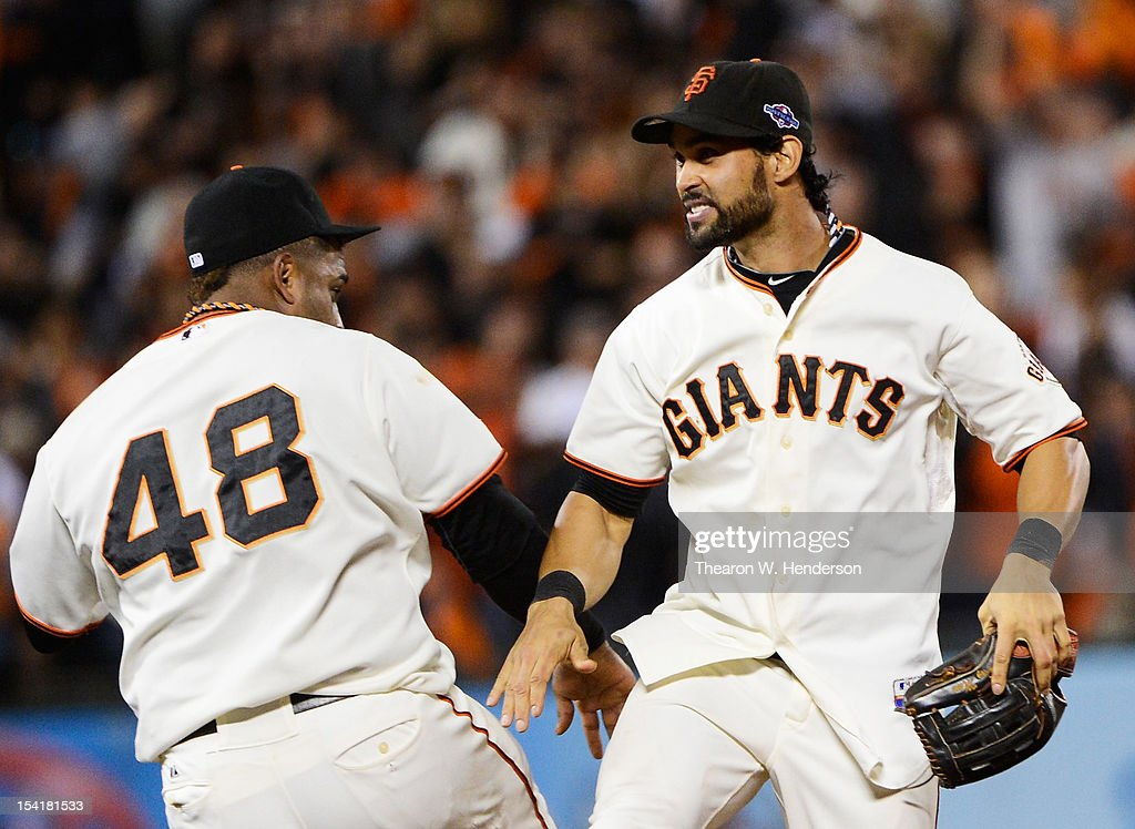 <a gi-track='captionPersonalityLinkClicked' href=/galleries/search?phrase=Pablo+Sandoval&family=editorial&specificpeople=803207 ng-click='$event.stopPropagation()'>Pablo Sandoval</a> #48 and <a gi-track='captionPersonalityLinkClicked' href=/galleries/search?phrase=Angel+Pagan&family=editorial&specificpeople=666596 ng-click='$event.stopPropagation()'>Angel Pagan</a> #16 of the San Francisco Giants celebrate their 7 to 1 win over the St. Louis Cardinals in Game Two of the National League Championship Series at AT&T Park on October 15, 2012 in San Francisco, California.
