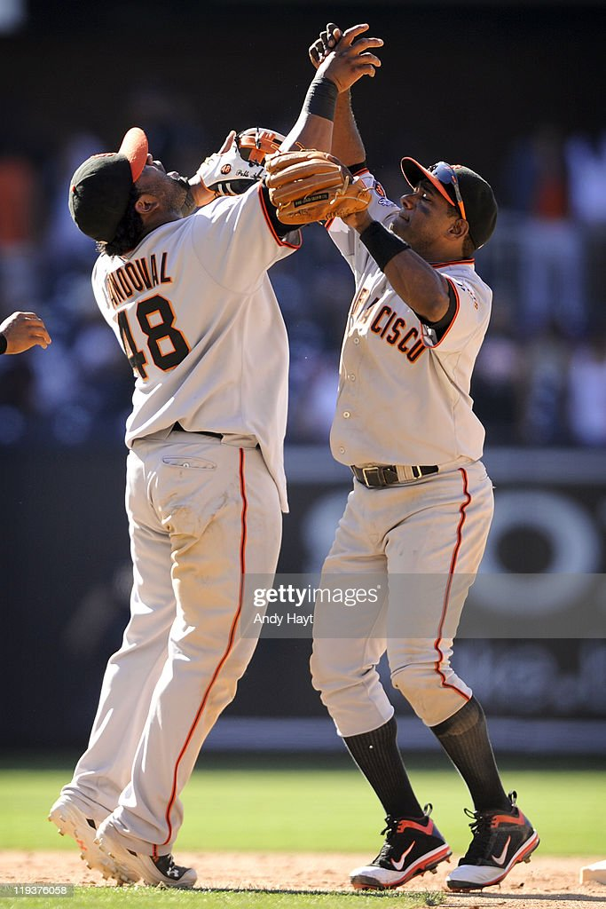 Pablo Sandoval #48 and Miguel Tejada #10 of the San Francisco Giants celebrate the final out against the San Diego Padres at Petco Park on July 17, 2011 in San Diego, CA. The San Francisco Giants won 4-3.