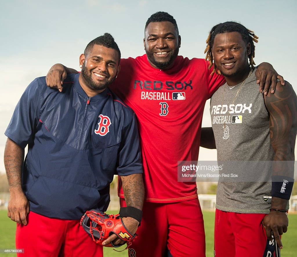 Pablo Sandoval David Ortiz and Hanley Ramirez of the Boston Red Sox pose for a photograph at jetBlue Park in Fort Myers Florida on February 24 2015