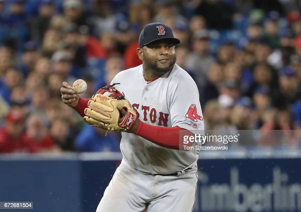 Pablo Sandoval of the Boston Red Sox bobbles a soft grounder at third base in the first inning during MLB game action as Troy Tulowitzki of the...