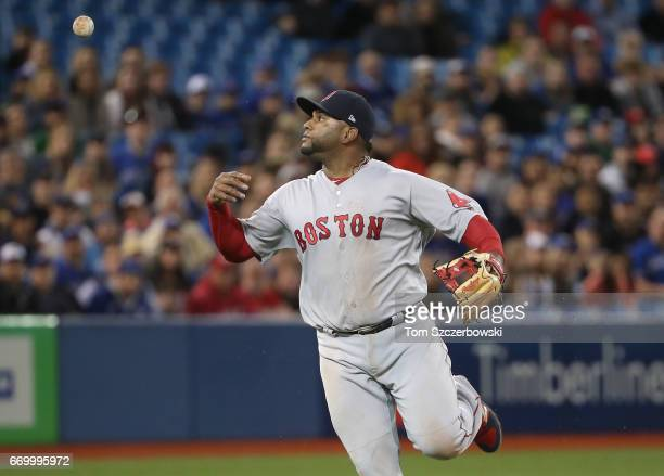 Pablo Sandoval of the Boston Red Sox bobbles a soft grounder in the first inning during MLB game action as Troy Tulowitzki of the Toronto Blue Jays...