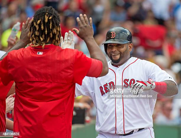 Pablo Sandoval of the Boston Red Sox celebrates after hitting a home run against the Seattle Mariners during the second inning at Fenway Park on...