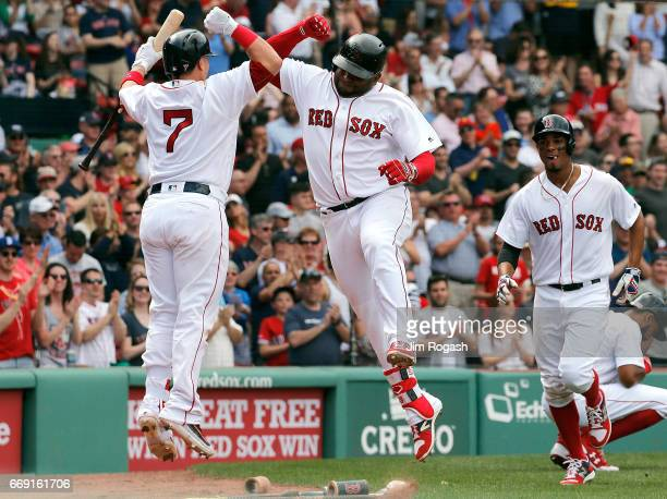 Pablo Sandoval of the Boston Red Sox celebrates his tworun home run with Christian Vazquez of the Boston Red Sox against the Tampa Bay Rays in the...