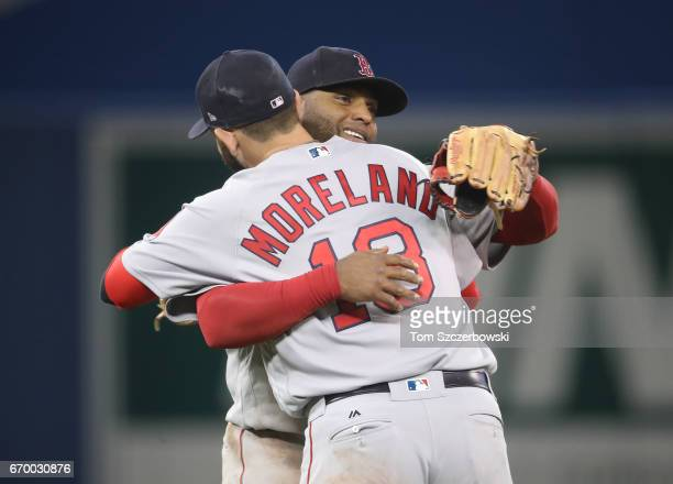 Pablo Sandoval of the Boston Red Sox celebrates their victory with Mitch Moreland during MLB game action against the Toronto Blue Jays at Rogers...