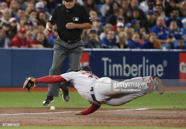 Pablo Sandoval of the Boston Red Sox dives but cannot get to a double hit by Kevin Pillar of the Toronto Blue Jays in the second inning during MLB...