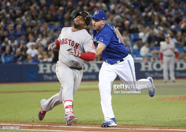 Pablo Sandoval of the Boston Red Sox is tagged out by Joe Biagini of the Toronto Blue Jays in the seventh inning during MLB game action at Rogers...