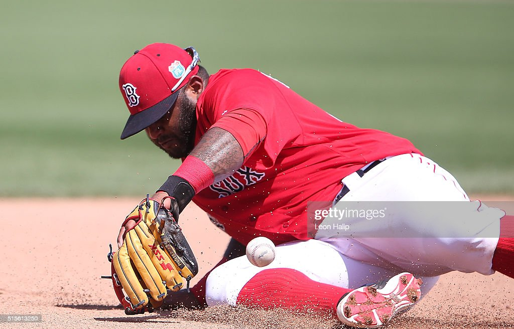 <a gi-track='captionPersonalityLinkClicked' href=/galleries/search?phrase=Pablo+Sandoval&family=editorial&specificpeople=803207 ng-click='$event.stopPropagation()'>Pablo Sandoval</a> #48 of the Boston Red Sox knocks the ball down at third base on the ground ball from Jason Rogers (not in photo) of the Pittsburgh Pirates an makes the play to first base for the out during the fourth inning of the Spring Training Game on March 14, 2016 at Jet Blue Park at Fenway South, Florida. The Pirates defeated the Red Sox 3-1.