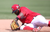 Pablo Sandoval of the Boston Red Sox knocks the ball down at third base on the ground ball from Jason Rogers of the Pittsburgh Pirates an makes the...