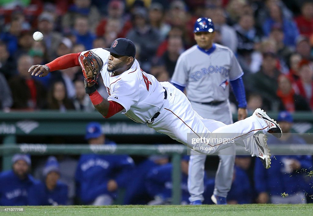 Pablo Sandoval #48 of the Boston Red Sox makes a catch on a soft line drive off the bat Dalton Pompey of the Toronto Blue Jays in the fourth inning at Fenway Park April 27, 2015 in Boston, Massachusetts.