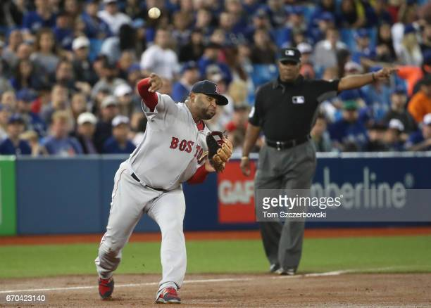 Pablo Sandoval of the Boston Red Sox makes a throwing error in the second inning during MLB game action against the Toronto Blue Jays at Rogers...
