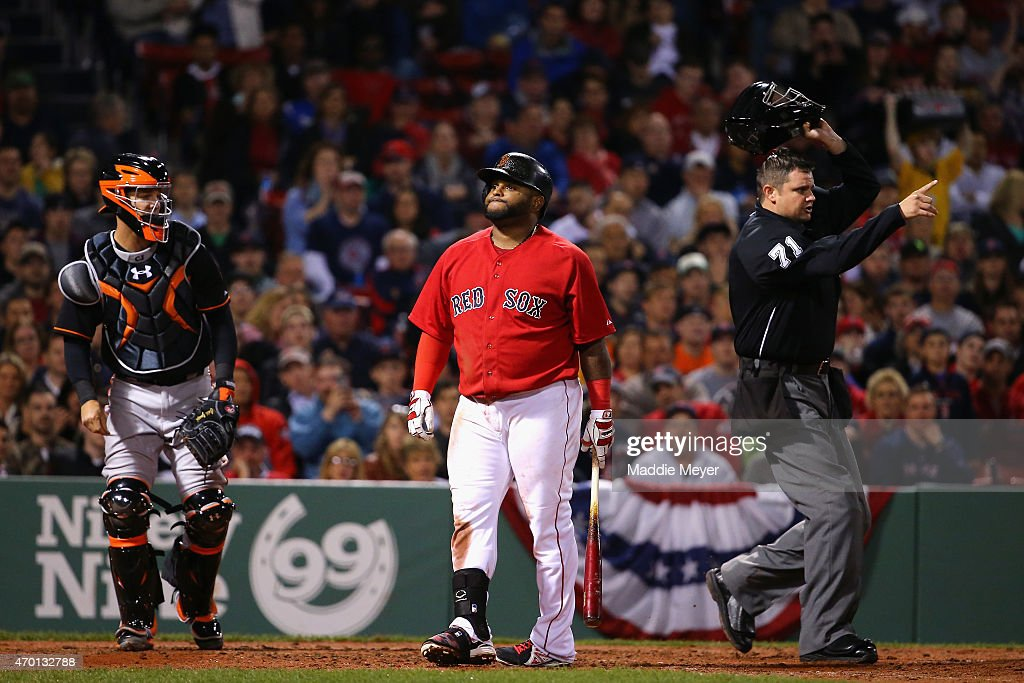 Pablo Sandoval #48 of the Boston Red Sox reacts after being struck in the back by a pitch from Ubaldo Jimenez #31 of the Baltimore Orioles during the fourth inning at Fenway Park on April 17, 2015 in Boston, Massachusetts. Home base umpire Jordan Baker #71, right, ejected Ubaldo Jimenez #31 from the game.
